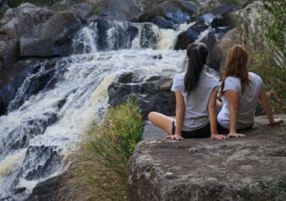 Girls at waterfall